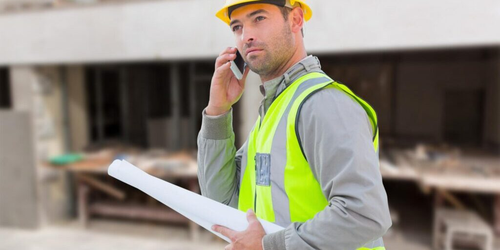male contractor taking phone call