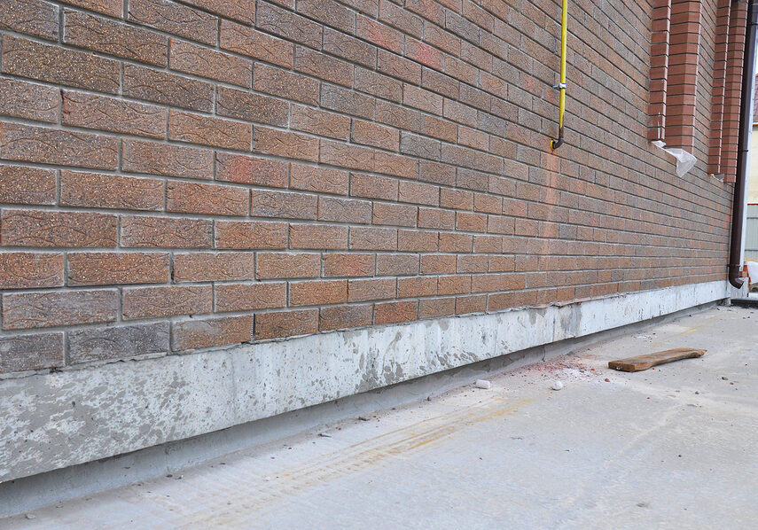 new construction waterproofing basement walls from outside. foundation waterproofing systems are applied externally so that water is prevented from penetrating through the foundation.