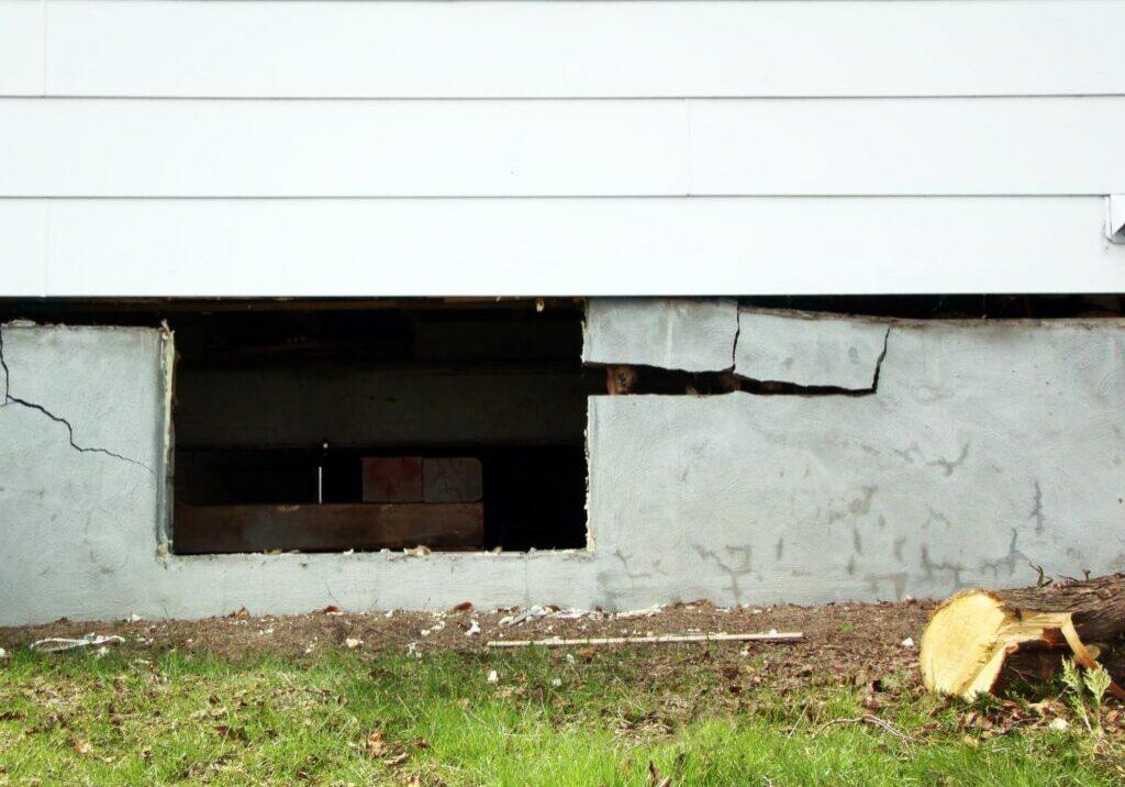an open and damage concrete cement basement/foundation